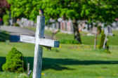 Wooden white cross in a cemetary — Stock Photo