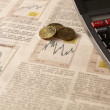 Stock Photo: Newspaper stock market with calculator and money