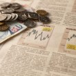 Stock Photo: Newspaper stock market with money