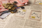 Newspaper stock market with money — Stock Photo