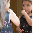 Portrait of little girl reflected in mirror — 图库照片