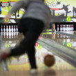 Men bowling out of focus - Stock Photo