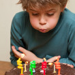 Cute boy at birthday cake — Stock Photo