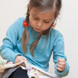 Little girl embroidering — Stock Photo