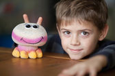 Smiling Boy and Alien Toy with Antennas — Stock Photo