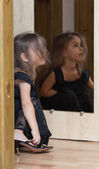 Little girl reflected in mirror — Stock Photo