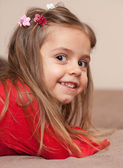 Portrait of smiling little girl — Stock Photo