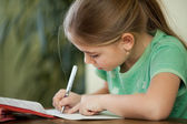 Pre-adolescent girl concentrates on her studies — Stock Photo
