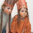Two little girls playing Indians — Stock Photo