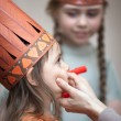 Stock Photo: Little girls preparing to play Indians