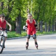 Cyclist and rollerblader — Stock Photo