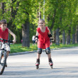 Cyclist and rollerblader — Stock Photo #24047675