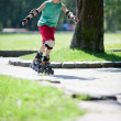 Stock Photo: Little boy on rollerblades
