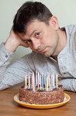 Man at birthday cake — Stock Photo