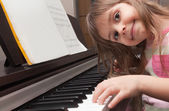 Little girl playing piano — Stock Photo