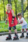 Sisters skating in park — Stock Photo