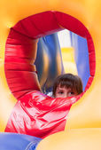 Little girl on inflatable slide — Stock Photo
