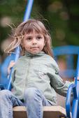 Little girl on a swing — Стоковое фото