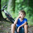 Постер, плакат: Little cyclist resting