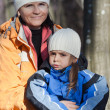 Photo: Portrait of mother and daughter outdoors
