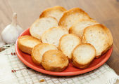 Garlic and garlic bread — Stock Photo