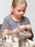 Little girl sculpts — Stock Photo