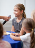 Child being interviewed — Stock Photo