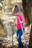 Little girl hiking in the woods — Stock Photo