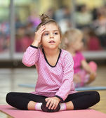 Little girl on mat — Stock Photo