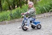 Little girl ( 4-5) on tricycle — Stock Photo