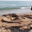 Building sand castle - Stock Photo