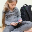 Stock Photo: Girl reading e-book