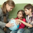 Kids looking at globe — Stock Photo #25958353