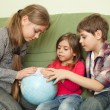 Kids looking at globe — Stock Photo #27286043