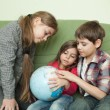 Kids looking at globe — Stock Photo #27286049