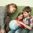 Kids looking at globe — Stock Photo