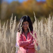 Woman on autumn meadow — Stock Photo