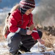 Child on the meadow in winter — Stock Photo