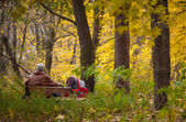 Grandpa with trolley in the Autumn park — Stock Photo