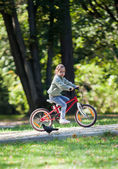 Little girl riding bike — Zdjęcie stockowe