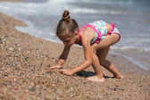 Little girl at the beach — Stock Photo