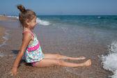 Happy little girl and sea — Stock Photo