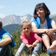 Family relaxing in the mountain — Stock Photo
