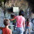 Family in the Grotto in Lourdes — Stock Photo