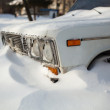 Stock Photo: White old car covered with snow
