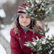 Portrait of a little girl and spruce — Stock Photo