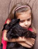 Miniature schnauzer and little girl — Stock Photo