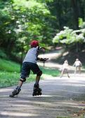 Kids rollerblading — Foto Stock