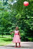 Little girl with balloon — Stock Photo