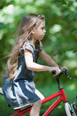 Little girl riding bicycle — Foto de Stock